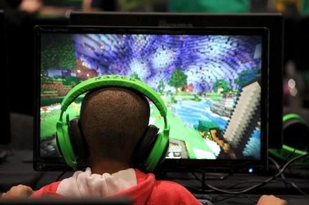 FILE PHOTO: Child plays video game Minecraft at the Minecon convention in London