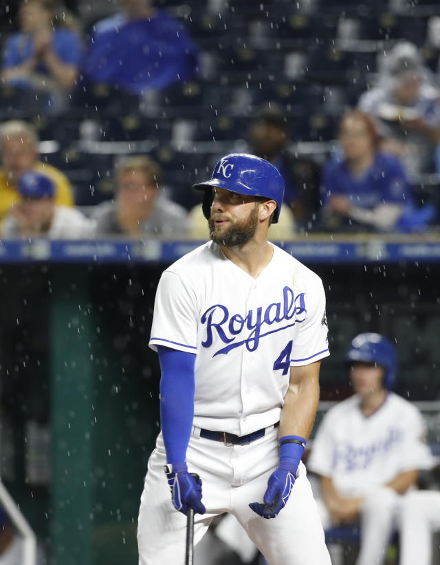 Kansas City Royals' Alex Gordon reacts as rain resumes in the first inning, after a two-hour rain delay before the start of the team's baseball game against the Toronto Blue Jays at Kauffman Stadium in Kansas City, Mo., Thursday, Aug. 16, 2018. (AP Photo/Colin E. Braley)