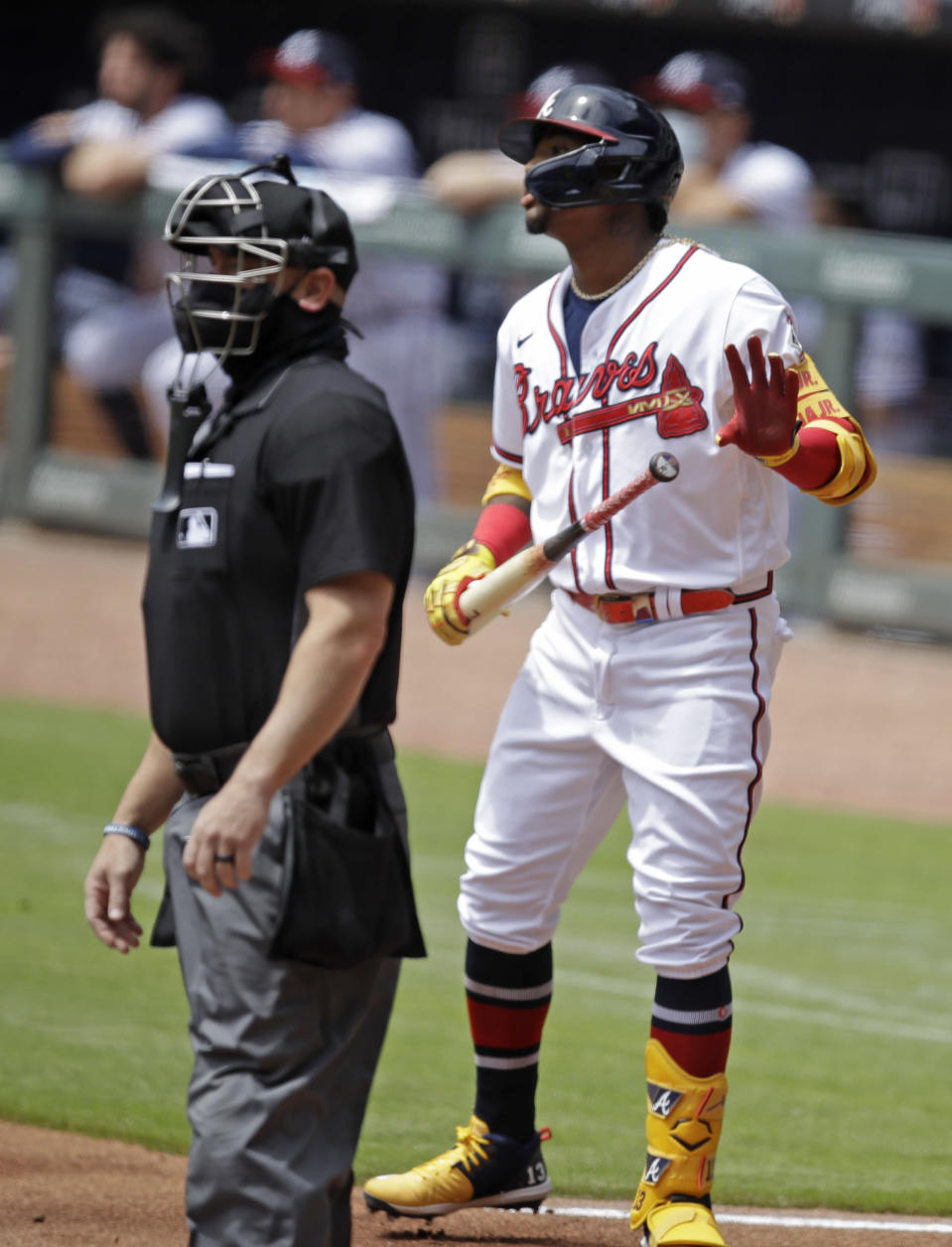 Atlanta Braves' Ronald Acuna Jr., right, watches to see if his home run hit off Toronto Blue Jays pitcher Ross Stripling stays fair in the first inning of a baseball game Thursday, May 13, 2021, in Atlanta. (AP Photo/Ben Margot)