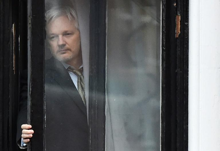 WikiLeaks founder Julian Assange seen at a window of Ecuador's embassy in London on February 5, 2016