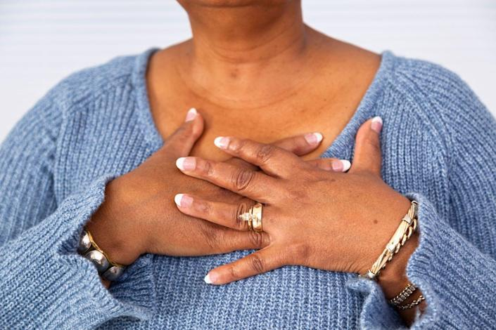 """<p>The very first symptom of a heart attack listed by the <a href=""""http://www.heart.org/HEARTORG/Conditions/HeartAttack/WarningSignsofaHeartAttack/Heart-Attack-Symptoms-in-Women_UCM_436448_Article.jsp#.Wp1qvJPwbUI"""" rel=""""nofollow noopener"""" target=""""_blank"""" data-ylk=""""slk:American Heart Association"""" class=""""link rapid-noclick-resp"""">American Heart Association</a> is """"uncomfortable pressure, squeezing, fullness, or pain in the center of your chest."""" <a href=""""https://www.womansday.com/health-fitness/womens-health/a26144012/susan-lucci-heart-health-scare/"""" rel=""""nofollow noopener"""" target=""""_blank"""" data-ylk=""""slk:This discomfort"""" class=""""link rapid-noclick-resp"""">This discomfort</a> may come in waves lasting more than a few minutes at a time.</p>"""