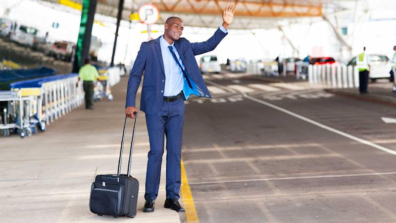 Businessman calling taxi at airport