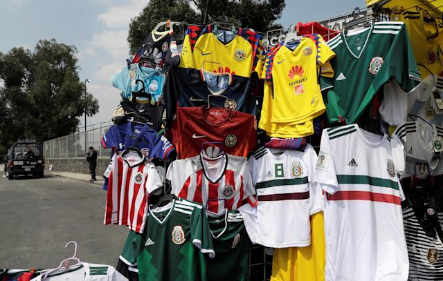 Mexican National soccer team and domestic football teams' shirts are displayed for sale outside the Azteca stadium of Mexican First Division in Mexico City, Mexico May 13, 2018. REUTERS/Henry Romero