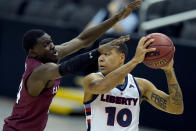South Carolina's Keyshawn Bryant pressures Liberty's Elijah Cuffee (10) during the second half of an NCAA college basketball game Saturday, Nov. 28, 2020, at the T-Mobile Center in Kansas City, Mo. (AP Photo/Charlie Riedel)