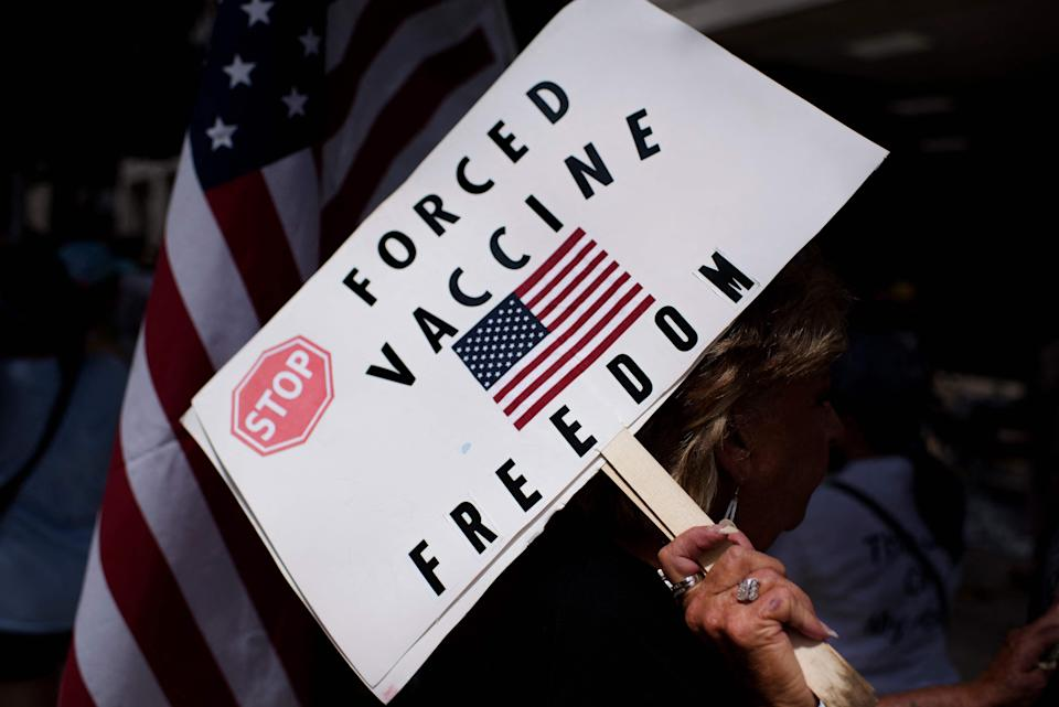 Anti-vaccine rally protesters hold signs outside of Houston Methodist Hospital in Houston, Texas, on June 26, 2021. - A spokesperson for Houston Methodist Hospital said on June 23, 153 employees either resign or were fired for refusing to be vaccinated.