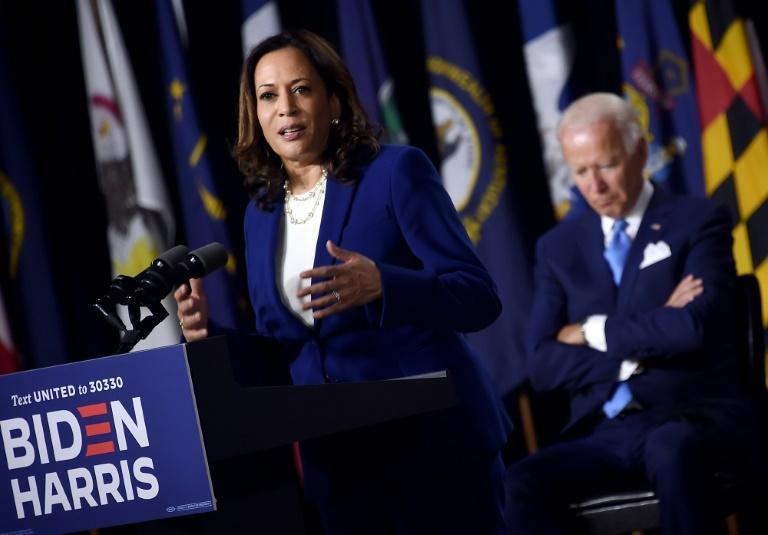 Democratic presidential hopeful Joe Biden listens as his VP pick Kamala Harris rolled out their campaign in Delaware, saying everything is 'on the line'