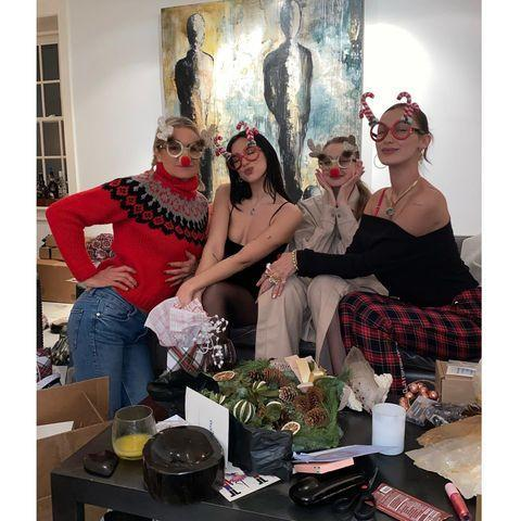 "<p>The famous matriarch shared numerous photos from her Christmas Day with her family on December 25. </p><p>In the series of images, Gigi, Bella and Dua Lipa - Anwar Hadid's girlfriend - snuggle up to Yolanda, while in another Zayn Malik and his girlfriend open a pink baby grow for their daughter. </p><p><a href=""https://www.instagram.com/p/CJWK2Avnqi9/?utm_source=ig_web_copy_link"" rel=""nofollow noopener"" target=""_blank"" data-ylk=""slk:See the original post on Instagram"" class=""link rapid-noclick-resp"">See the original post on Instagram</a></p>"