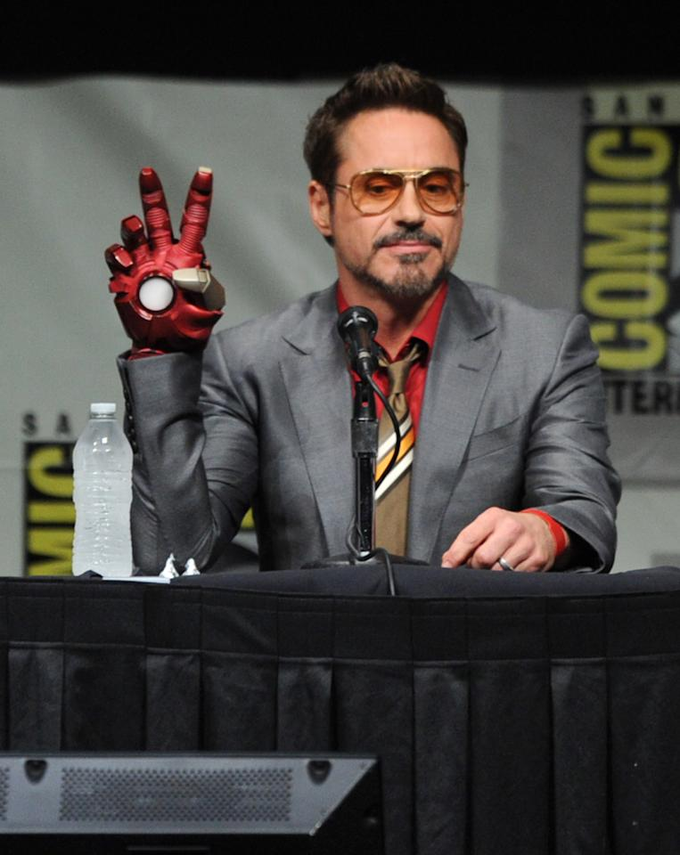 """SAN DIEGO, CA - JULY 14:  Actor Robert Downey Jr. speaks at Marvel Studios """"Iron Man 3"""" panel during Comic-Con International 2012 at San Diego Convention Center on July 14, 2012 in San Diego, California.  (Photo by Kevin Winter/Getty Images)"""