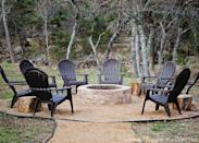 """<p>For a fire pit the whole family can enjoy, use granite, sand, or pea gravel to make a wide circle around the pit. It's safer, and when surrounded by adirondack chairs, it creates a """"room"""" in your yard.</p><p><strong>Get the tutorial at <a href=""""https://www.scatteredthoughtsofacraftymom.com/how-to-make-a-fire-pit/"""" rel=""""nofollow noopener"""" target=""""_blank"""" data-ylk=""""slk:Scattered Thoughts of a Crafty Mom"""" class=""""link rapid-noclick-resp"""">Scattered Thoughts of a Crafty Mom</a>.</strong></p><p><a class=""""link rapid-noclick-resp"""" href=""""https://www.amazon.com/dp/B001J5KJD8/?tag=syn-yahoo-20&ascsubtag=%5Bartid%7C10050.g.31966151%5Bsrc%7Cyahoo-us"""" rel=""""nofollow noopener"""" target=""""_blank"""" data-ylk=""""slk:SHOP ADIRONDACK CHAIRS"""">SHOP ADIRONDACK CHAIRS</a><br> </p>"""