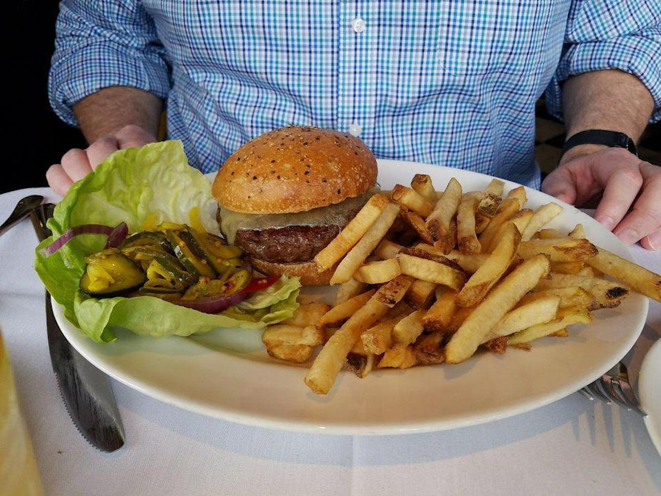<p>There are all kinds of tasty things on the menu at Mustards Grill, but the cheeseburger at this Napa Valley, California, destination is one of the true stars. Made simple without overwhelming toppings, the cheeseburger is topped with lettuce and mayo and served on a bakery bun with a side of fries.</p>
