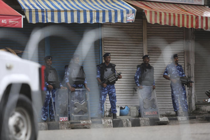 Rapid Action Force (RAF) soldiers stand guard in Jammu, India, Friday, Aug. 9, 2019. The restrictions on public movement throughout Kashmir have forced people to stay indoors and closed shops and even clinics. All communications and the internet have been cut off. Prime Minister Modi said late Thursday the situation in the region would return to normal gradually. (AP Photo/Channi Anand)