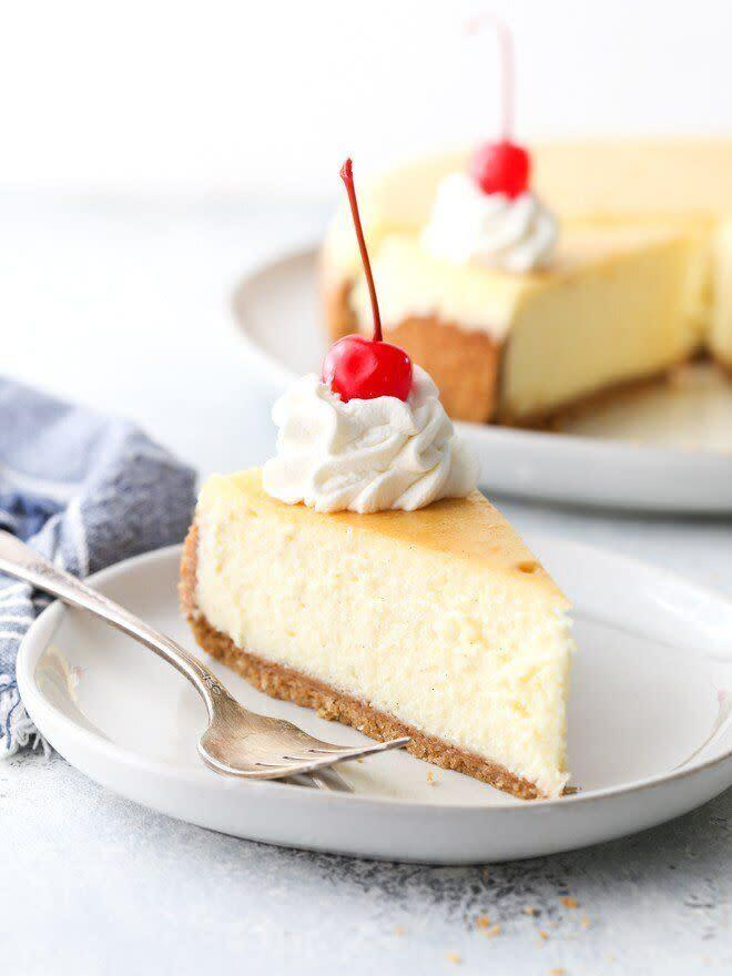 """<a href=""""https://www.completelydelicious.com/classic-cheesecake/"""" rel=""""nofollow noopener"""" target=""""_blank"""" data-ylk=""""slk:Get the Classic Cheesecake recipe from Completely Delicious"""" class=""""link rapid-noclick-resp""""><strong>Get the Classic Cheesecake recipe from Completely Delicious</strong></a>"""