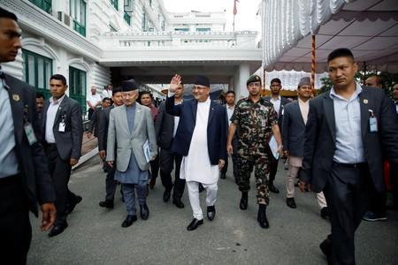 Nepal's Prime Minister Khadga Prasad Sharma Oli, also known as K.P. Oli, smiles as he walks out after the inauguration of the Motihari-Amlekhganj petroleum pipeline project at Singha Durbar, in Kathmandu