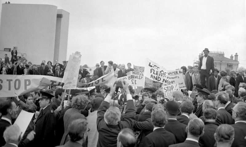 Angry local residents surround Michael Heseltine, then parliamentary secretary at the Ministry of Transport, as he opens the Westway, a 2.5 mile-long road that runs from Marylebone to Shepherd's Bush.