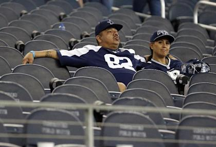 Cowboys fans sit in their seats after the team's 28-17 loss. (AP)