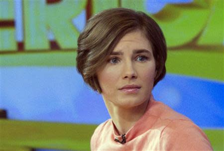 """Amanda Knox reacts while being interviewed on the set of ABC's """"Good Morning America"""" in New York January 31, 2014. REUTERS/Andrew Kelly"""