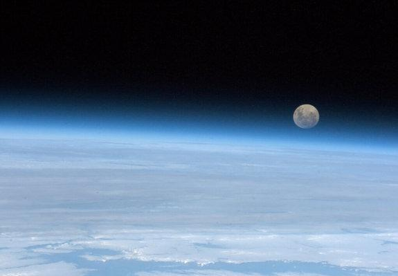 """Astronaut Chris Hadfield snapped this photo of a full moon on Jan. 30 from the International Space Station. """"Full Moon rising. So near, and yet..."""" he wrote."""