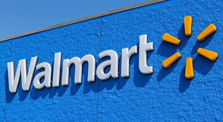 Image of Walmart (WMT) logo on Walmart store with clear blue sky in the background