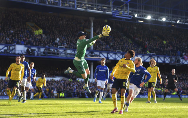 Everton goalkeeper Jordan Pickford, center, collects the ball during the English Premier League soccer match between Everton and Arsenal at Goodison Park, Liverpool, England, Saturday, Dec. 21, 2019. (Anthony Devlin/PA via AP)