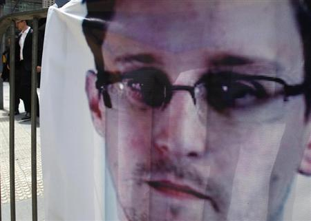A banner supporting Edward Snowden is displayed at Hong Kong's financial Central district