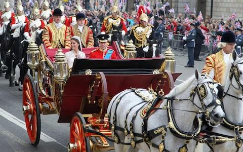 The Duke and Duchess of Cambridge during their wedding carriage procession in 2011 - Credit: Matt Cardy/AP