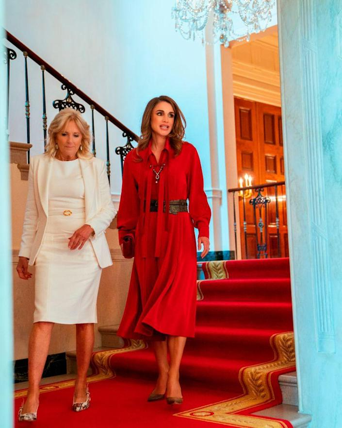 Queen Rania of Jordan meets First Lady of the United States Jill Biden at the White House in Washinton DC, on July 19, 2021, during a working visit. - Credit: AP
