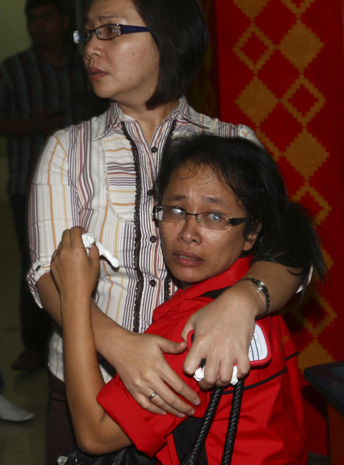 An Indonesian woman is comforted by a relative as she waits for the latest news on a missing Russian airplane at Halim Perdanakusuma Airport in Jakarta, Indonesia, Wednesday, May 9, 2012. The Russian-made Sukhoi Superjet-100 carrying 46 people lost contact with air controllers while flying over mountains during a demonstration flight Wednesday in western Indonesia, officials said. (AP Photo/Tatan Syuflana)
