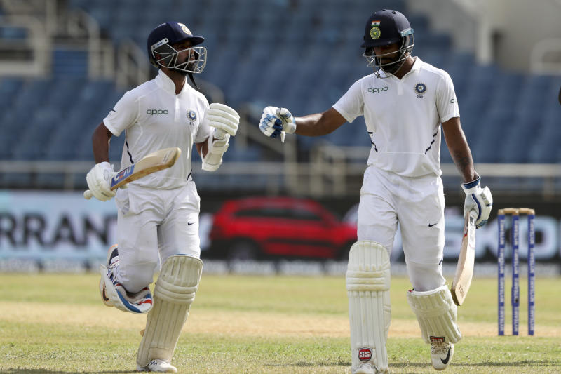India's batsmen Ajinkya Rahane, left, and Hanuma Vihari leave the field after declaring their second innings against West Indies with a lead of 467 runs with 6 wickets remaining during day three of the second Test cricket match at Sabina Park cricket ground in Kingston, Jamaica Sunday, Sept. 1, 2019. (AP Photo/Ricardo Mazalan)