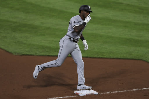 Chicago White Sox's Tim Anderson reacts while running the bases after hitting a solo home run in the fifth inning during a baseball game against the Cincinnati Reds in Cincinnati, Saturday, Sept. 19, 2020. (AP Photo/Aaron Doster)
