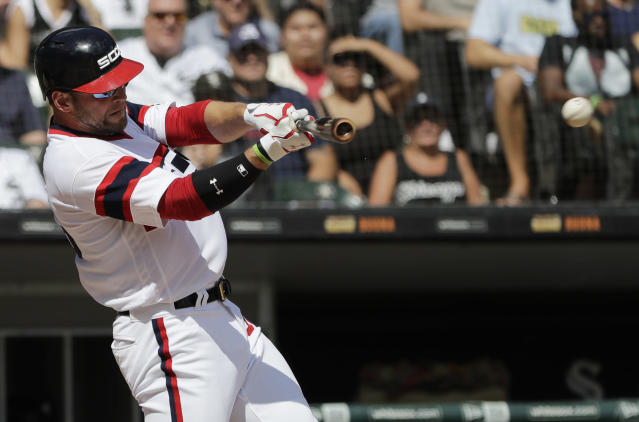 Chicago White Sox's Kevan Smith hits a one-run single during the first inning of a baseball game against the Boston Red Sox, Sunday, Sept. 2, 2018, in Chicago. (AP Photo/Nam Y. Huh)