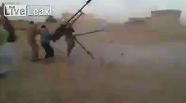 The gun fires sporadically as the pair lose control. Source: LIveLeak
