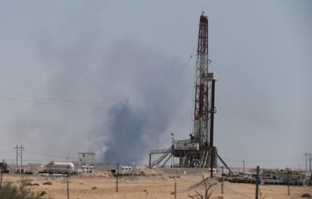 Smoke is seen following a fire at Aramco facility in the eastern city of Abqaiq
