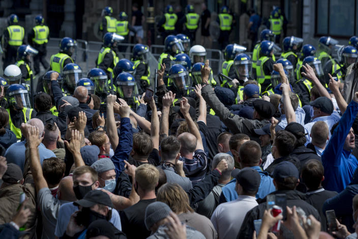 A week after a Black Lives Matter protest turned to violence when the statue of wartime Prime Minister Sir Winston Churchill was daubed in graffiti which called him a racist, and despite warning from police not to attend protests at all today - and to be off the streets by 5.00pm - a large group crowd of right-wing groups and veterans gathered at the boxed-in statue to 'protect it from further vandalism' by Black Lives Matter and anti-racism protesters. Riot police stopped the right-wing groups from proceeding up Whitehall where the Cenotaph was also behind a screen, resulting in scuffles, on 13th June 2020, in London, England. (Photo by Richard Baker / In Pictures via Getty Images)