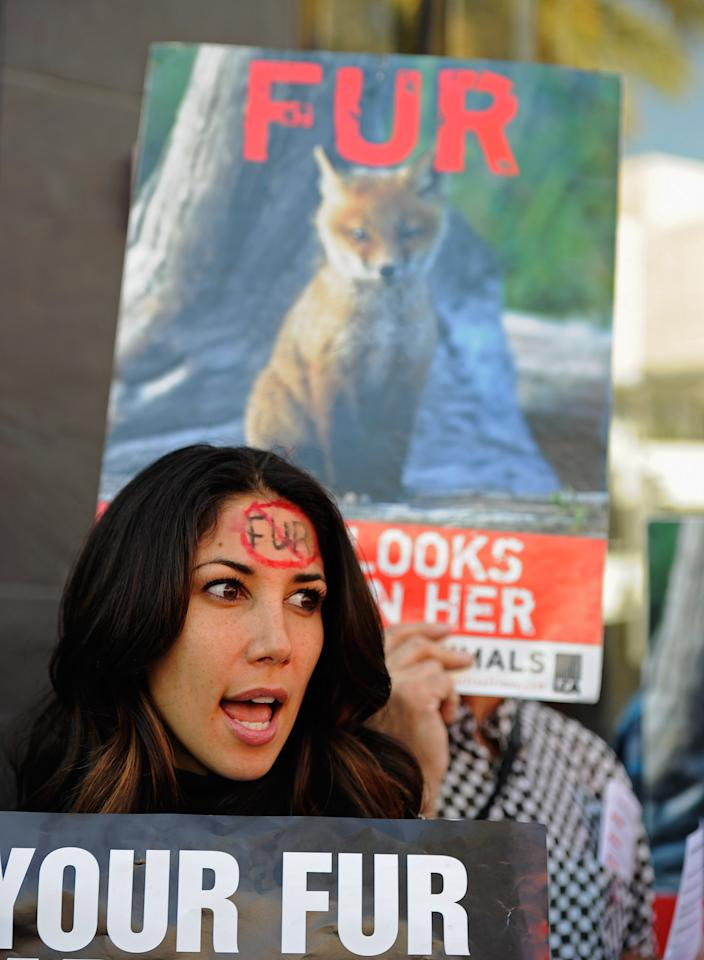BEVERLY HILLS, CA - NOVEMBER 25:  Reality television personality and former Miss Great Britain Leilani Dowding (L) takes part in an anti-fur demonstration urging Black Friday shoppers to stop buying fur-related products on November 25, 2011 in Beverly Hills, California. Neighboring city West Hollywood unanimously approved an ordinance to ban the sale of fur clothing, the first such ban in the United States.  (Photo by Kevork Djansezian/Getty Images)