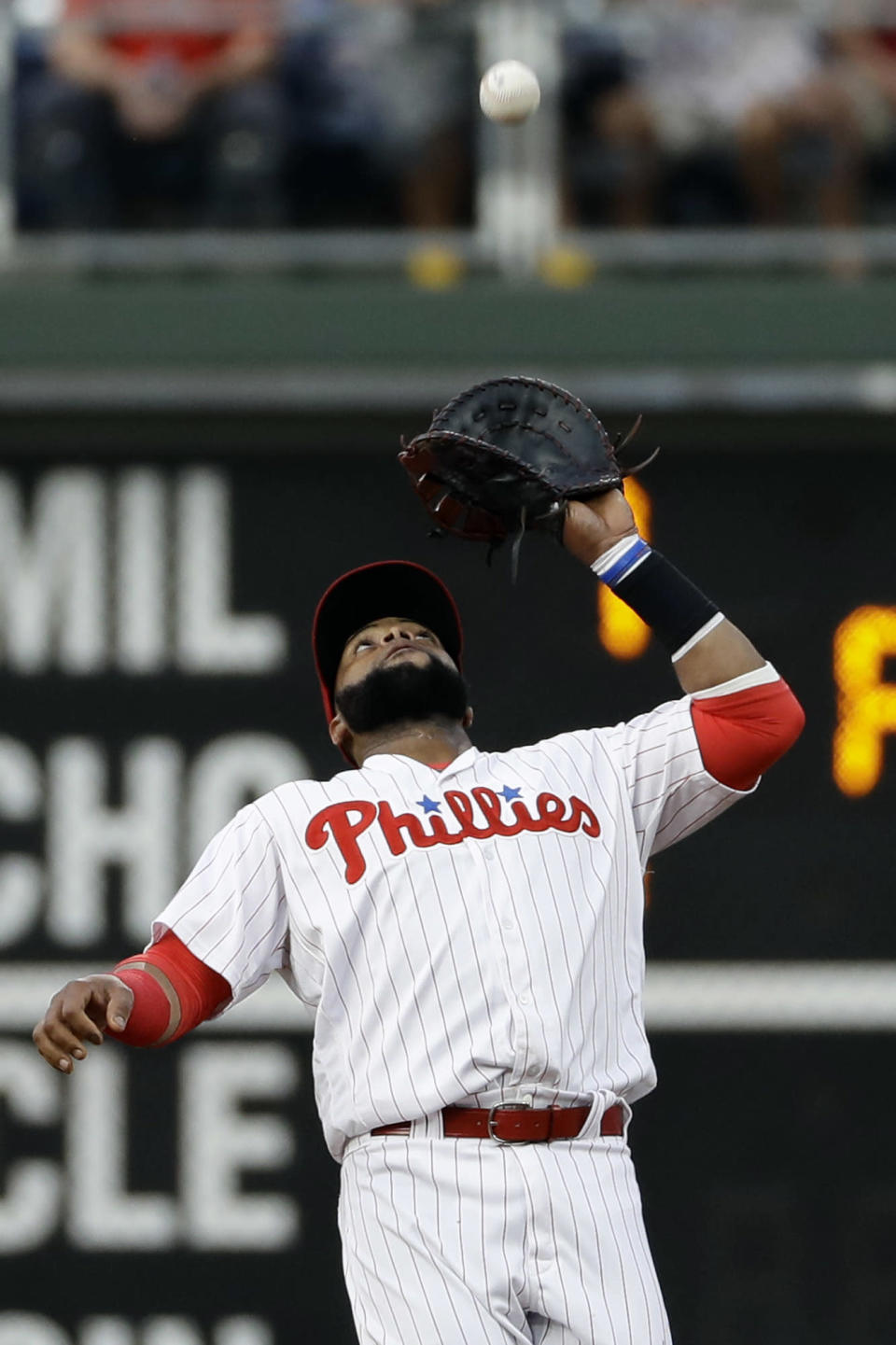 Philadelphia Phillies first baseman Carlos Santana catches a fly ball by Boston Red Sox's Mookie Betts during the first inning of a baseball game, Tuesday, Aug. 14, 2018, in Philadelphia. (AP Photo/Matt Slocum)
