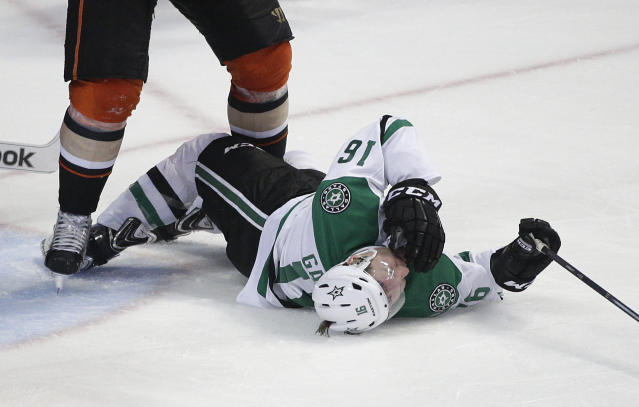 Dallas Stars' Ryan Garbutt falls to the ice after he was checked by Anaheim Ducks' Bryan Allen during the third period in Game 1 of the first-round NHL hockey Stanley Cup playoff series on Wednesday, April 16, 2014, in Anaheim, Calif. The Ducks won 4-3. (AP Photo/Jae C. Hong)