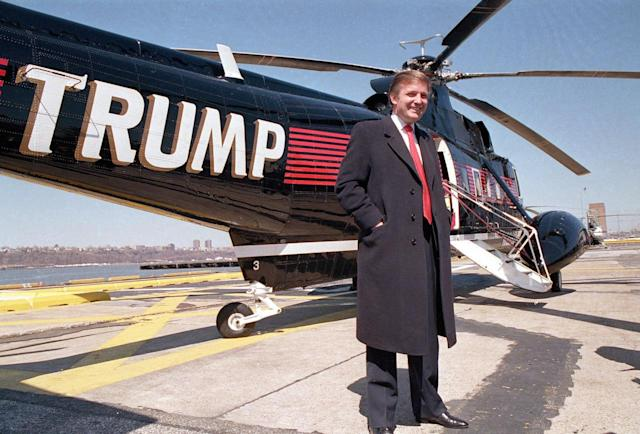 <p>Donald Trump poses in front of one of three Sikorsky helicopters at New York Port Authority's West 30 Street heliport on March 22, 1988. <i>(Photo: Wilbur Funches/AP)</i> </p>
