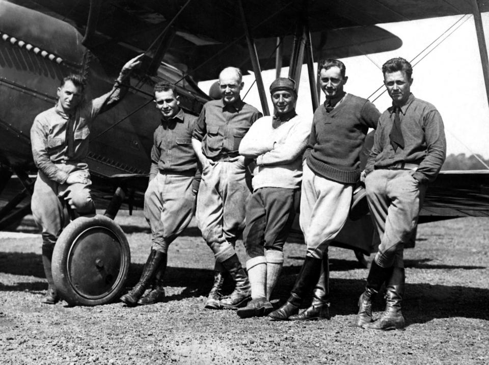 UNITED STATES - CIRCA 1924:  From The Left To The Right, The Guides Henry Ogden And Leigh Wade, The Lieutenants Erick Nelson, John Harding, P. Leslie Arnold And Lowell H. Smith Who Made The First World Tour By Plane Within 175 Days, Posing On Their Plane Douglas World Cruiser At The Boston Airport, At Their Arrival In 1924.  (Photo by Keystone-France/Gamma-Keystone via Getty Images)