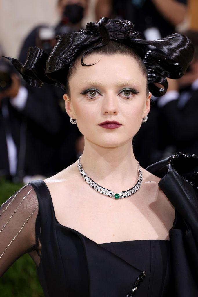 <p>In true Met Gala spirit, Maisie Williams's avant-garde guise blended The Matrix-inspired make-up, with vacant brows and graphic eyes, alongside a lacquered sculptural up-do.</p>