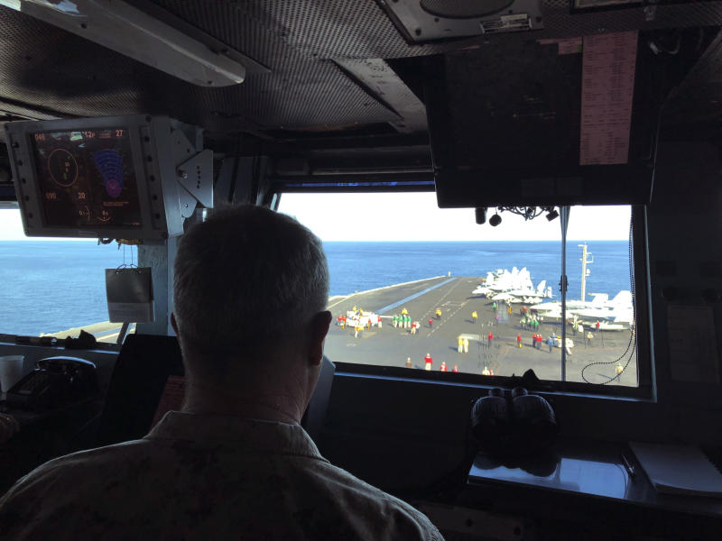 Marine Gen. Frank McKenzie, top U.S. commander for the Middle East, watches flight operations on board the USS Harry S. Truman, Saturday, Feb. 1, 2020, in the North Arabian Sea. Nearly a month after Iran launched a rare direct military attack against United States forces in Iraq, an uneasy quiet has settled across the region.Watching fighter jets roar off the flight deck of the USS Harry S. Truman, the top U.S. commander for the Middle East believes he is surrounded by one of the reasons that Iran has dialed back it's combat stance, at least for now. He says the presence of an aircraft carrier make a potential adversary think twice about war. But he and other commanders on the ship agree that deterrence is hard to measure. (AP Photo/Lolita Baldor)