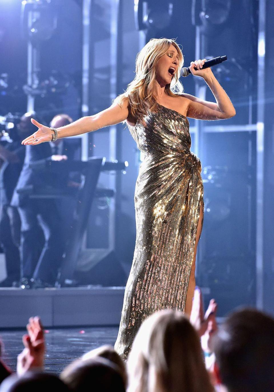 <p>Looking like a gilded Lady Liberty, Dion belted out lyrics at the 2016 Billboard Music Awards in a stunning sequined gold gown and matching gold lids.</p>