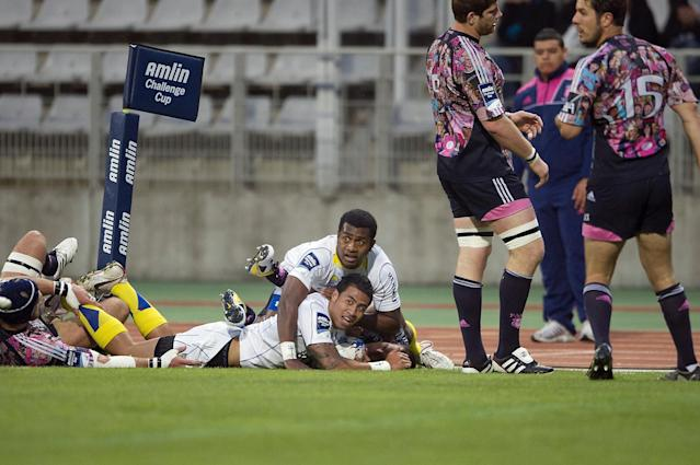Clermont's fullback George Pisi (bottom) celebrates with his teammate Wesley Fofana after scoring a try during the European Challenge Cup semi final rugby union match Stade Francais vs. Clermont at the Charlety stadium in Paris on April 29, 2011. AFP PHOTO / BERTRAND LANGLOIS (Photo credit should read BERTRAND LANGLOIS/AFP/Getty Images)