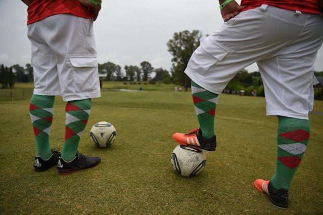 Participants compete in the second edition of the Footgolf World Cup at Pilar Golf and Country Club near Buenos Aires on January 10, 2016 (AFP Photo/Eitan Abramovich)