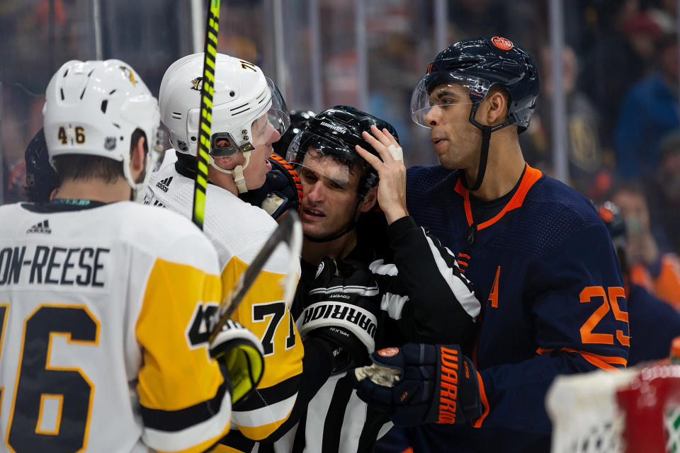 Edmonton Oilers' Darnell Nurse (25) shouts at Pittsburgh Penguins' Evgeni Malkin (71) during the third period of an NHL hockey game Friday, Dec. 20, 2019, in Edmonton, Alberta. (Codie McLachlan/The Canadian Press via AP)