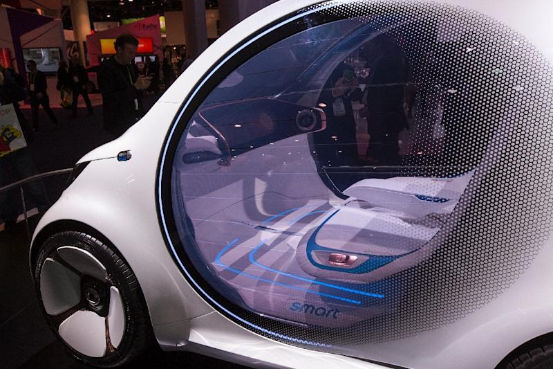 An autonomous Mercedes-Benz Smart Vision EQ concept car with no steering wheels or pedals on display at CES in Las Vegas (AFP Photo/DAVID MCNEW)