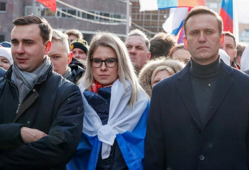 FILE PHOTO: Russian opposition politicians Navalny, Sobol and Zhdanov take part in a rally to mark the 5th anniversary of opposition politician Boris Nemtsov's murder and to protest against proposed amendments to the country's constitution, in Moscow