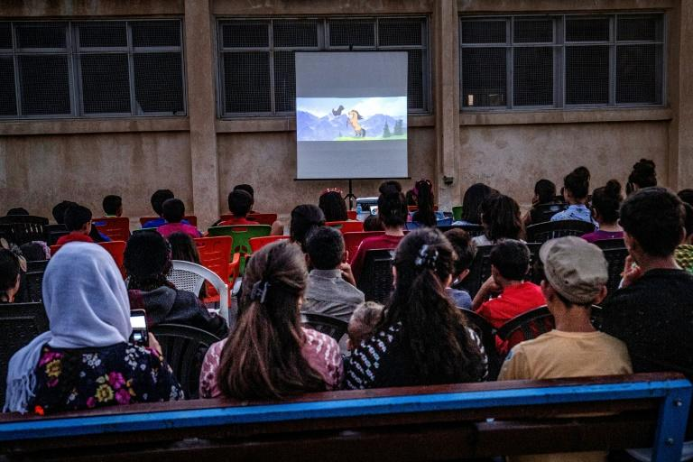 Filmmaker Shero Hinde is taking a mobile cinema around remote villages in rural northeastern Syria to share the magic of the movies with children (AFP Photo/DELIL SOULEIMAN)