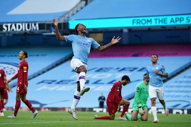 Raheem Sterling celebrates Manchester City's second goal against Liverpool (AFP Photo/Dave Thompson)
