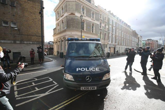A police van arrives at Westminster Magistrates' Court on Saturday morning
