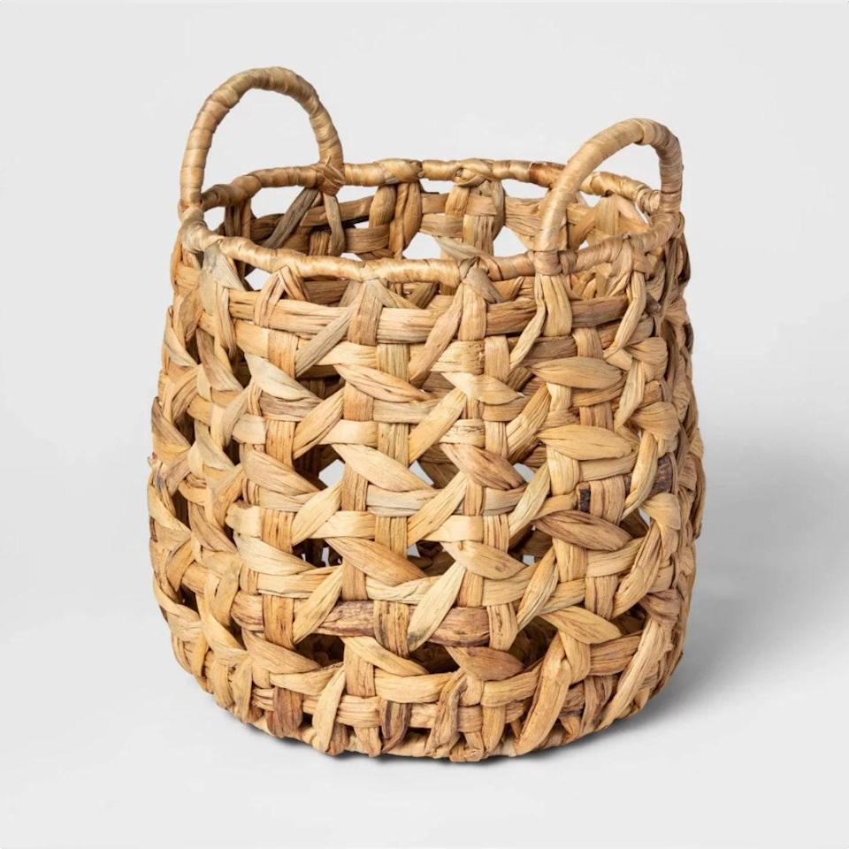 "Give your entire family the gift of less clutter: One of these baskets left at the bottom of a flight of stairs and a second at the top means there's a go-to spot to corral belongings that have gone astray, a designated place to check first for anything that's AWOL—<em>and</em> an easy way to transport all of it back to its intended location. $19, Target. <a href=""https://www.target.com/p/decorative-cane-pattern-8-sided-open-weave-basket-natural-threshold-8482/-/A-53803657"" rel=""nofollow noopener"" target=""_blank"" data-ylk=""slk:Get it now!"" class=""link rapid-noclick-resp"">Get it now!</a>"